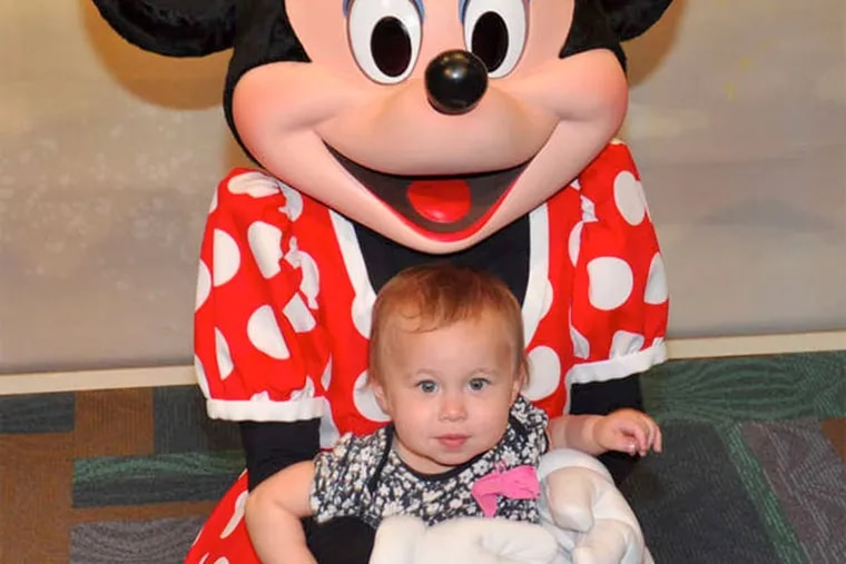 Dan Gross' daughter Piper with Minnie Mouse.