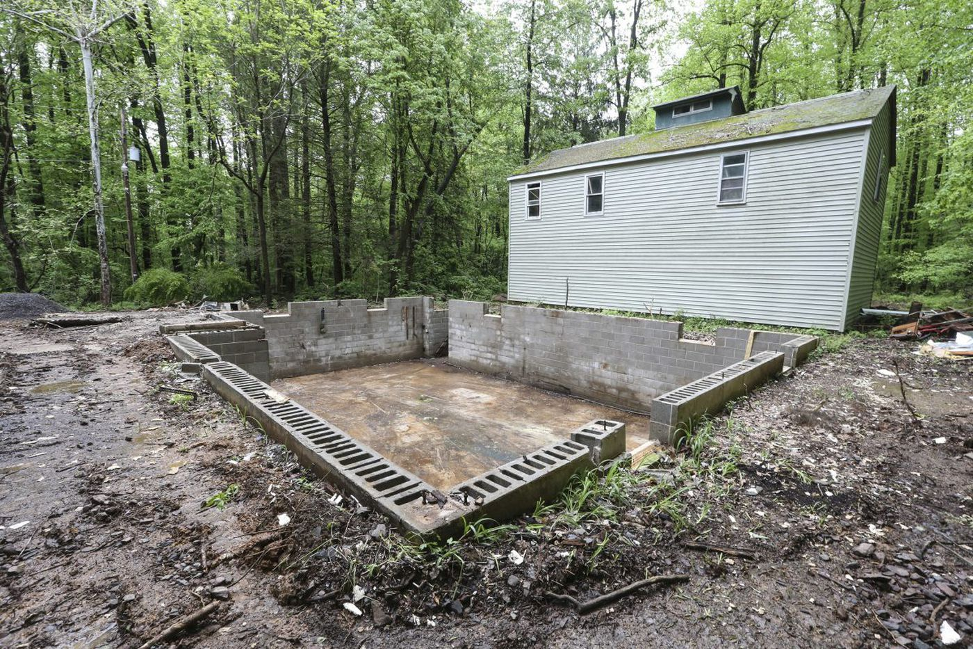 Police hope remnants of Bucks County home, once owned by a murderer, holds clues about long-missing man