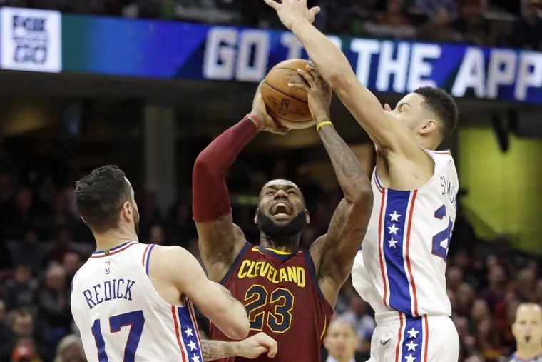 Cleveland's LeBron James recorded a triple-double with 30 points, 13 rebounds, and 13 assists Saturday against the Sixers.