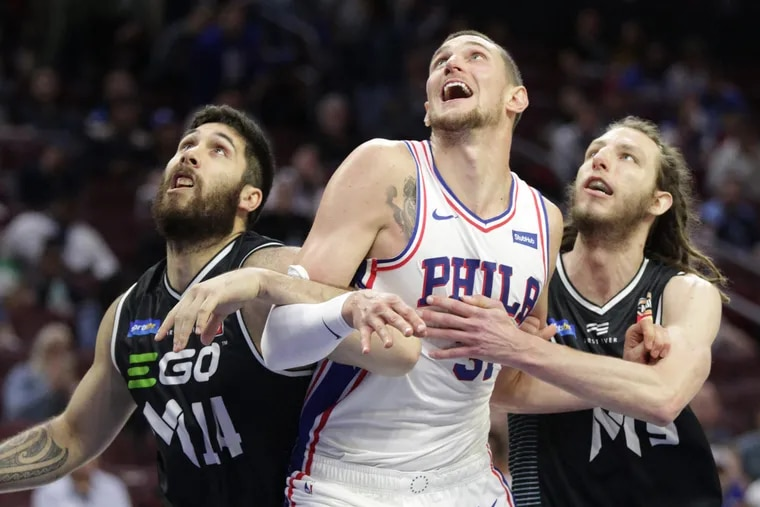 Mike Muscala (center) and Wilson Chandler won't necessarily fit seamlessly into the holes left by Ersan Ilyasova and Marco Belinelli, but they will be serviceable.