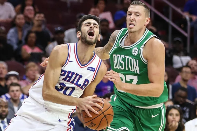 Sixers' sharpshooter Furkan Korkmaz draws a foul against the Celtics in the first night of the Las Vegas summer league on Friday.