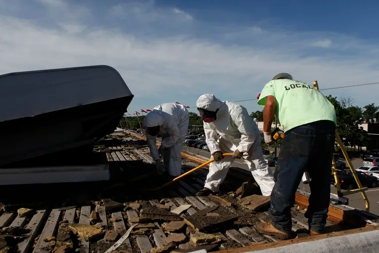 Danny Henry (right) and his coworker work on the roof of Bellmawr Post Office in New Jersey. They work for EDA Contractors, which has been training its construction leaders to be emotionally intelligent.