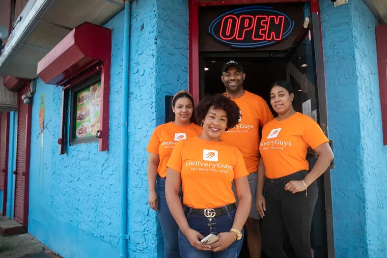Delivery Guys owner Víctor Tejada and three of his drivers who deliver food in North and Northeast Philadelphia: (clockwise from left) Lorainy Espinal, Tejada, Nathalie Zapata, and Katty Corporán.