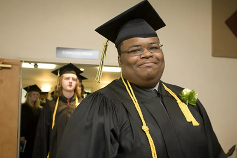Larry E. Campbell Jr. smiles as he walks in the graduation procession of Wyncote Academy yesterday. He was shot seven times in 2007 but pushed himself to recover and graduated with honors. (Ed Hille / Staff Photographer)