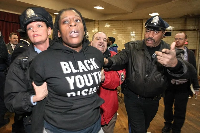 When the Lawncrest town hall meeting started protesters moved in on the panel, with the Police Commissioner and the DA, a melee ensued resulting in about a dozen arrests on Mar. 19, 2015.        ( STEVEN M. FALK / Staff Photographer )