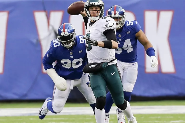 Eagles quarterback Nick Foles throws the football past New York Giants defensive end Jason Pierre-Paul (left) and defensive end Olivier Vernon during the third-quarter on Sunday, December 17, 2017.