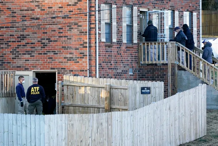 FBI and ATF agents investigate a home Saturday, Dec. 26, 2020, in Nashville, Tenn. An explosion that shook the largely deserted streets of downtown Nashville early Christmas morning shattered windows, damaged buildings, and wounded three people. Authorities said they believed the blast was intentional.