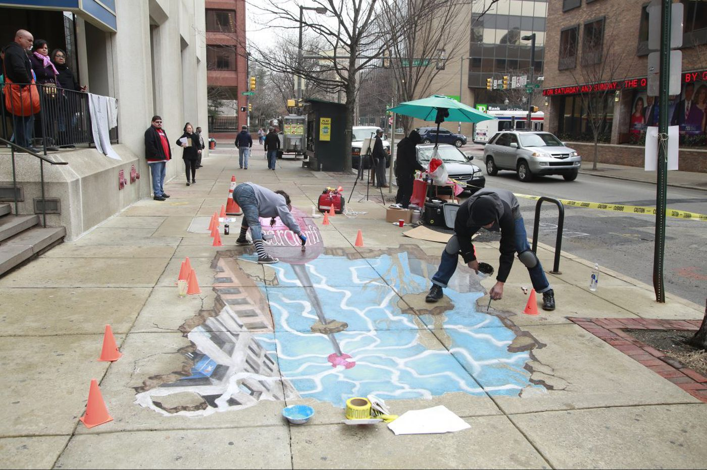 A 3-D chalk mural appears in Old City