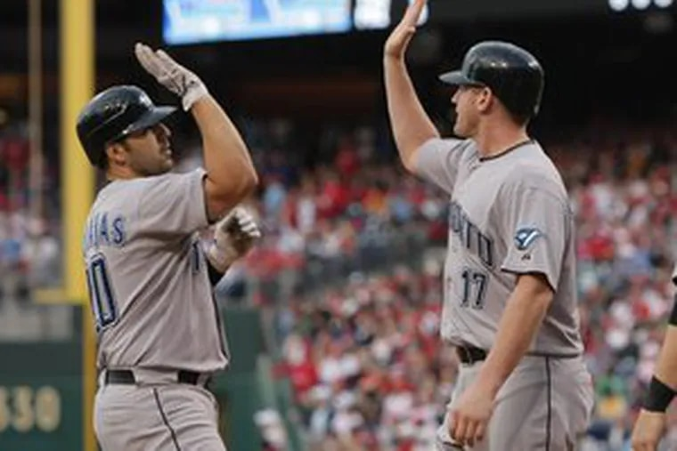 Rod Barajas (left) is greeted by Lyle Overbay after the former Phillies flop hit a grand slam. The catcher was not warmly welcomed back.