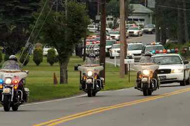 MARK MORAN / The (Wilkes-Barre) Citizens' Voice A Pa. State Police escort drives past the home of slain Trooper Joshua Miller in Pittston Twp., Luzerne County. Miller was shotto death Sunday.