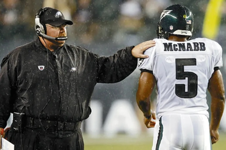 Eagles coach Andy Reid and quarterback Donovan McNabb have had a great run together, making it to four NFC title games and one Super Bowl. (David Maialetti / Staff Photographer)