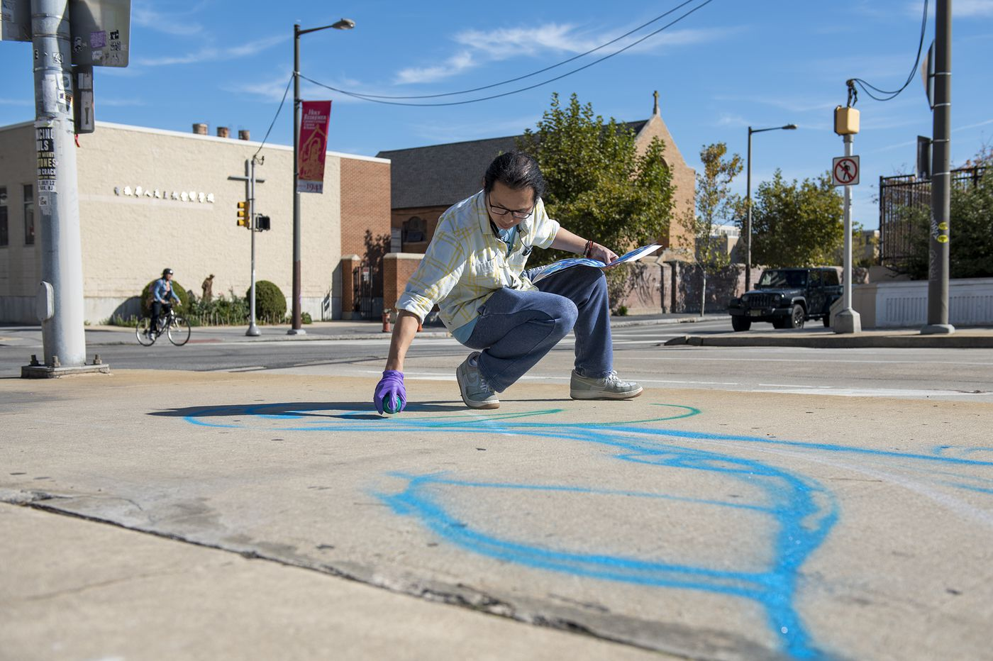 This Chinese artist just started his dream project of painting a mural in Philadelphia's Chinatown