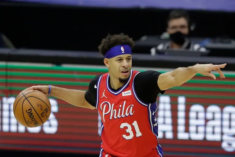 Sixers guard Seth Curry points with the basketball during the first quarter against the Boston Celtics on Friday, January 22, 2021 in Philadelphia.