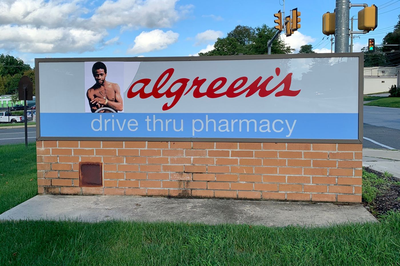 A street artist brought 'Love and Happiness' to a West Chester Walgreens sign