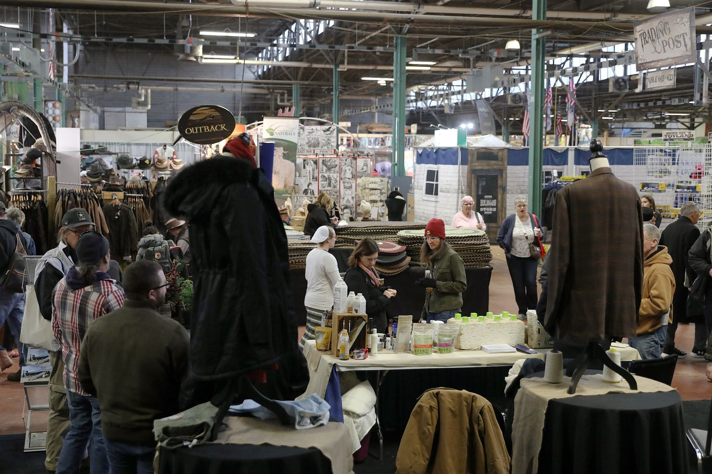 Attendees browse the Pennsylvania Hemp Industry Council's exhibit, which includes examples of hemp clothing, during the annual Pennsylvania Farm Show in the Pennsylvania Farm Show Complex & Expo Center in Harrisburg, Pa., on Tuesday, Jan. 7, 2020.