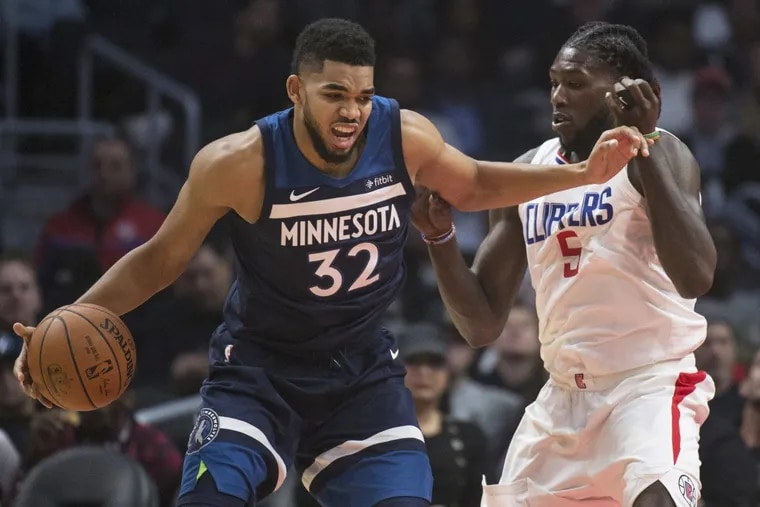 Timberwolves center Karl-Anthony Towns, left, trying to drive past Clippers forward Montrezl Harrell on Dec. 6.