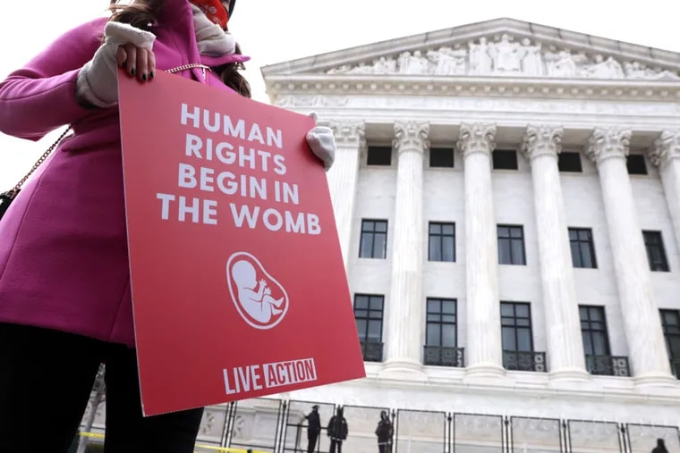 An anti-abortion protester at a January demonstration outside the U.S. Supreme Court. Activists in Pennsylvania are calling on lawmakers to pass a bill that would restrict abortion after six weeks gestation.