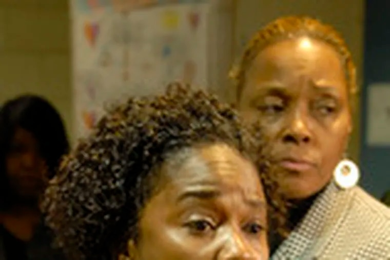 Yolanda Dyches, aunt of shooting suspect Dwayne Dyches, speaks to reporters. Behind her is Paula Peebles of the National Action Network.