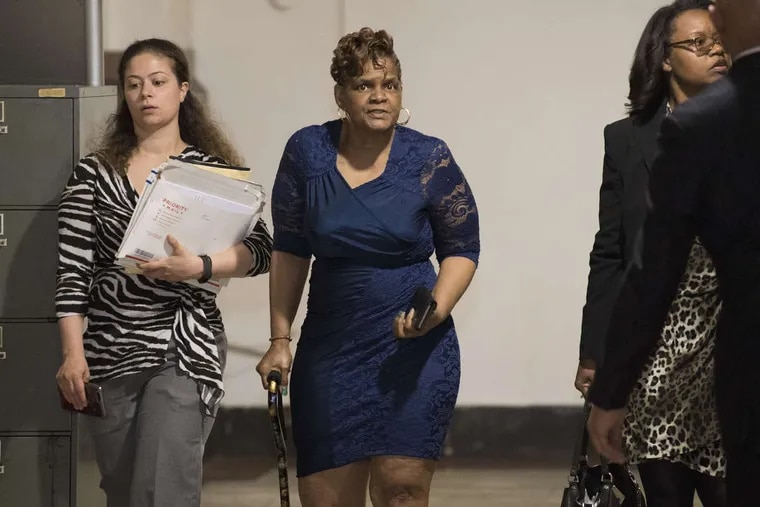 Gloria Byars, center,  walked inside Philadelphia City Hall in May 2018 for a prior hearing before Orphans' Court Judge John Herron. At right was her attorney, Sharon Alexander; at left was an assistant.