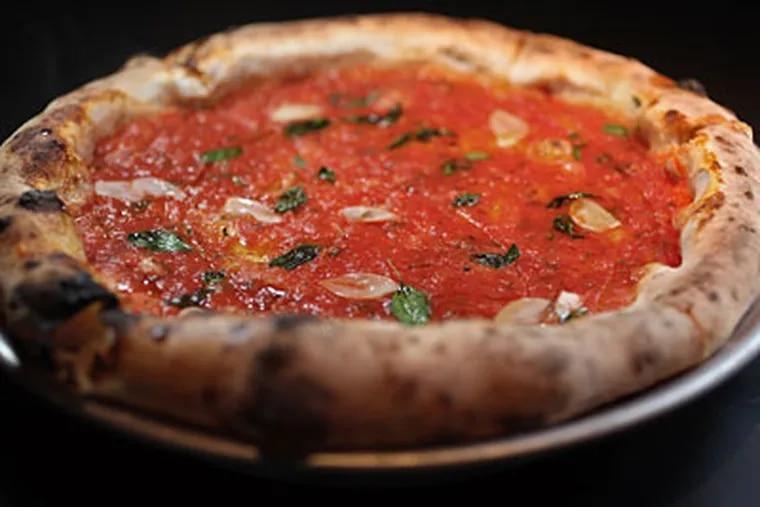 Marinara pizza, an outstanding Neapolitan pie with tomato, oregano and garlic. (DAVID M WARREN / Staff Photographer)
