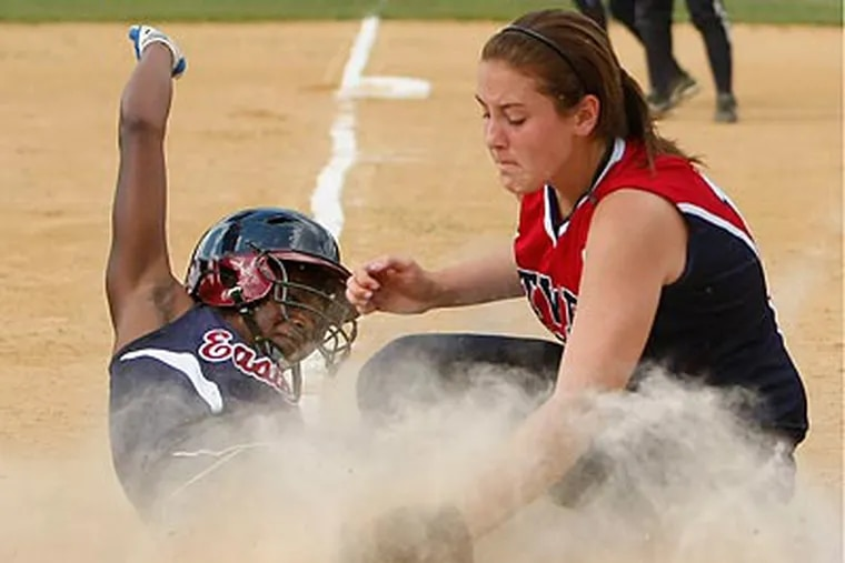 Eastern's Cherelle Chambers scores on a wild pitch by Washington Township pitcher Alissa Schoelkopf, who is covering the plate. (Ron Cortes / Staff Photographer)