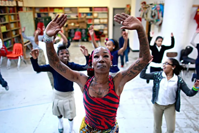 Ama Schley of the Kulu Mele African Dance and Drum Ensemble teaches students at the Folk Arts-Cultural Treasures Charter School. The Philadelphia Folklore Project is involved in running the school. DAVID SWANSON / Staff Photographer