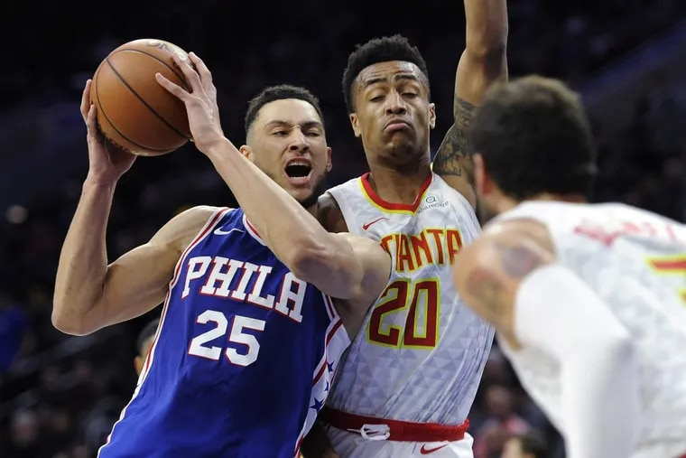 Ben Simmons (25) drives to the basket as Atlanta's John Collins defends during the second half Wednesday night.