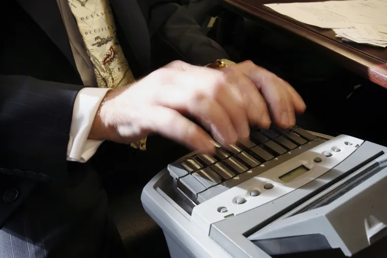 A court stenographer at work.