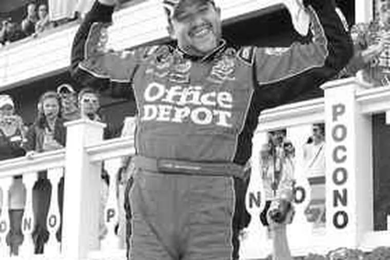 Tony Stewart celebrates his victory in the Pocono 500.