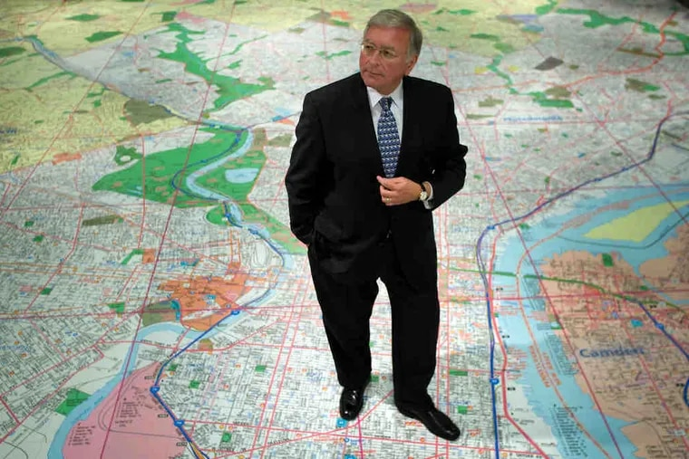Charles Croce, new head of the Philadelphia History Museum at the Atwater Kent, stands on a large floor map of the region.
