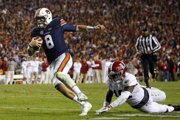 Quarterback Jarrett Stidham led Auburn past Alabama last week. This week's challenge is Georgia in the SEC title game. (AP Photo/Butch Dill)