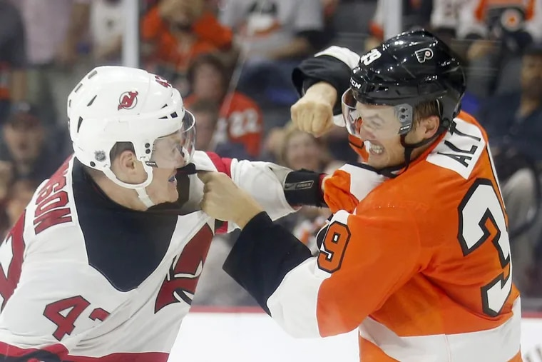 Mark Alt fights New Jersey Devils Ben Thomson during the second-period in a preseason game in 2016.