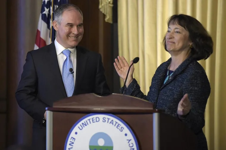 Environmental Protection Agency Administrator Scott Pruitt smiles as he is introduced by acting EPA Administrator Catherine McCabe in Washington on Feb. 21, 2017.