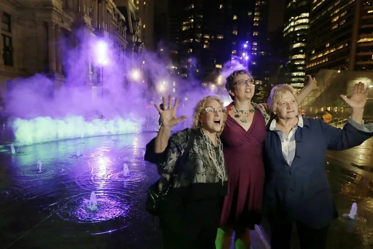 From left, Penny Balkin Bach of Philadelphia, artist Janet Echelman, and landscape architect Susan Weiler during the activation of the first phase of Pulse, a site-specific work of public art by Echelman, at Dilworth Park in front of City Hall in Philadelphia on Sept. 12, 2018.