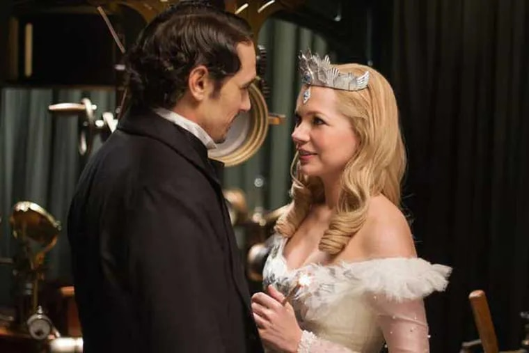 """This film image released by Disney Enterprises shows James Franco, left, and Michelle Williams in a scene from """"Oz the Great and Powerful."""" (AP Photo/Disney Enterprises, Merie Weismiller Wallace)"""