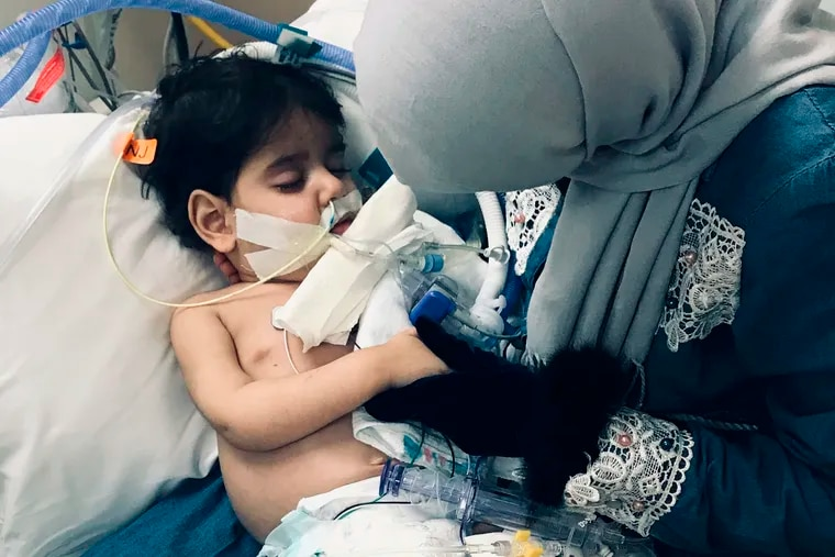 In this December 2018 photo released by the Council on American Islamic Relations, Sacramento Valley, Shaima Swileh, of Yemen, holds her dying 2-year old son, Abdullah Hassan, at UCSF Benioff Children's Hospital in Oakland, Calif. The Council on American-Islamic Relations announced Friday, Dec. 28, 2018, that Abdullah died at the Oakland hospital, where his father Ali Hassan brought him in the fall to get treatment for a genetic brain disorder. Swileh, who is not an American citizen, sued the Trump administration to let her into the country to be with the ailing boy. (Council on American Islamic Relations, Sacramento Valley via AP)