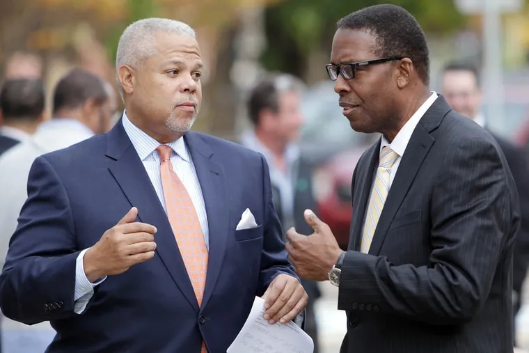 State Sen. Anthony Hardy Williams, left, and Council president Darrell Clarke talk outside Famous 4th Street Deli on November 4, 2014. ( DAVID MAIALETTI / Staff Photographer )