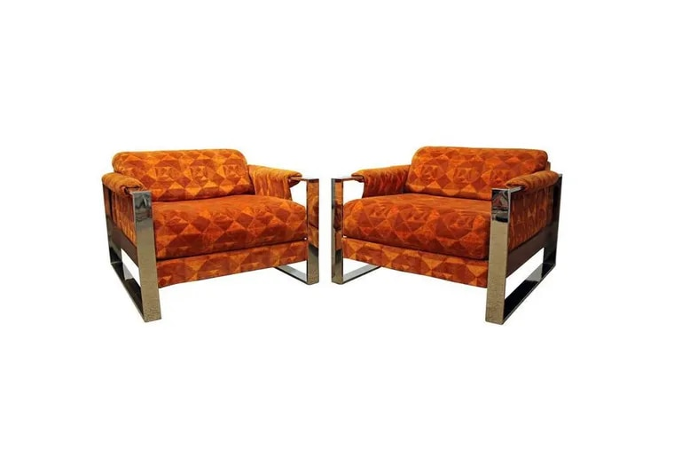 An online platform, ATTIC showcases vintage furniture and home decor from local, independent businesses. This pair of Mid-Century Modern Adrian Pearsall Craft Associates Chrome Lounge Chairs, featuring geometric orange upholstery and chrome base, from Annex Marketplace is one of the many current listings on the site.