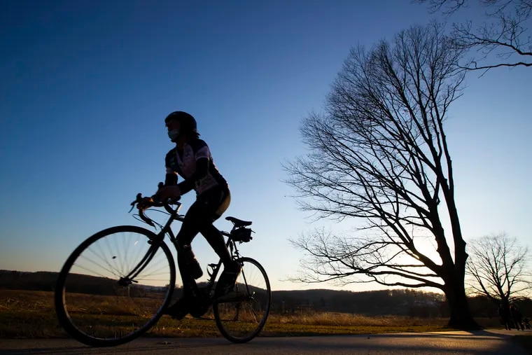 A cyclist takes advantage of the warmer temperatures to get a ride in at Valley Forge National Historical Park on March 3, 2021.