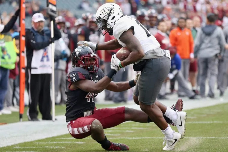 UCF wide receiver Marlon Williams (17) attempts to fend off Temple linebacker Todd Jones (40) during a game at Lincoln Financial Field on Saturday, Nov 18, 2017. Temple lost 45-19. TIM TAI / Staff Photographer