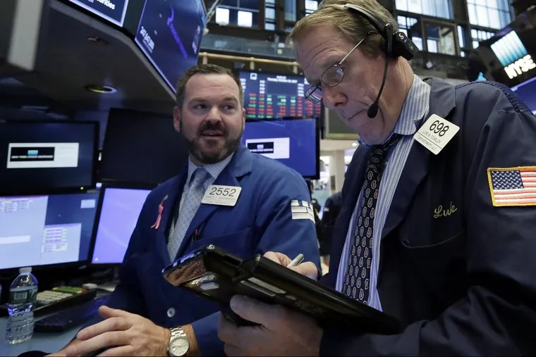 """Specialist and trader on the """"open outcry"""" floor of the New York Stock Exchange, 2017. Since the market's biggest one-day crash 30 years ago, trading has accelerated to digital speeds, but markets remain fragile mechanisms that depend on cooperation between regulators and capitalists, Wall Street writer Diana Henriques argues in her book, A First-Class Catastrophe"""