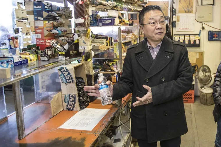 Adam Xu, chairman of the Asian American Licensed Beverage Association of Philadelphia, speaking at the Wayne Junction Deli, a beer deli in Logan, on Nov. 27, 2017, said the businesses need the barrier windows for safety reasons.