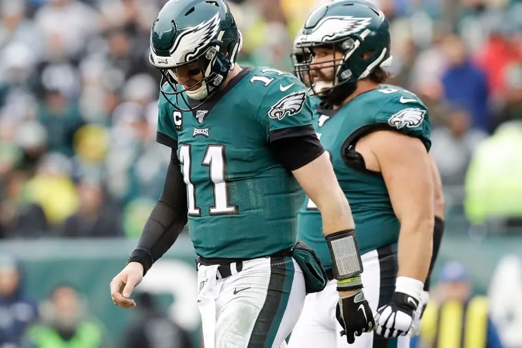 Eagles quarterback Carson Wentz walks off the field late in the second quarter.