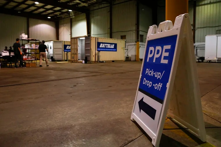 A sign indicating PPE pick-up and drop-off at a warehouse in Glen Mills, Delaware County on Friday, May 1, 2020.  Battelle was awarded a contract by the U.S Department of Health and Human Services (HHS) and the Federal Emergency Management Agency (FEMA) to provide N95 decontamination at no charge.
