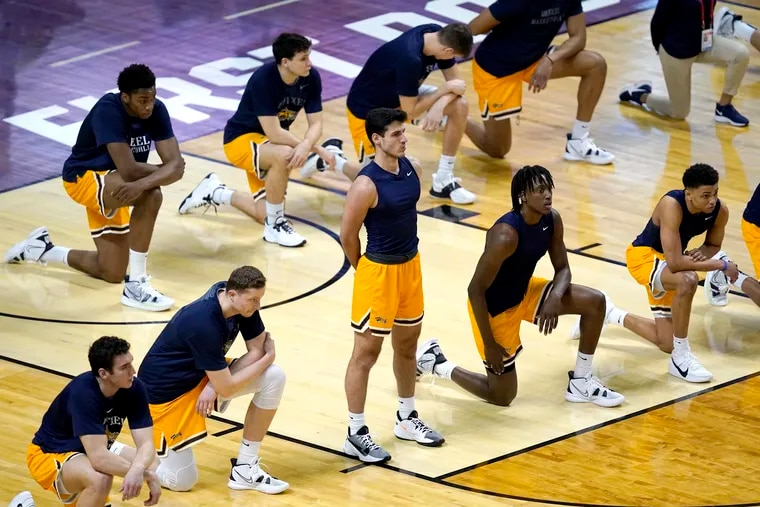 Members of the Drexel basketball team pause for the national anthem before a first-round NCAA Tournament game against Illinois.
