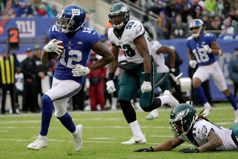 Eagles Ronald Darby (right) couldn't catch the Giants' Tavarres King (left) on his way to a touchdown in the third quarter.