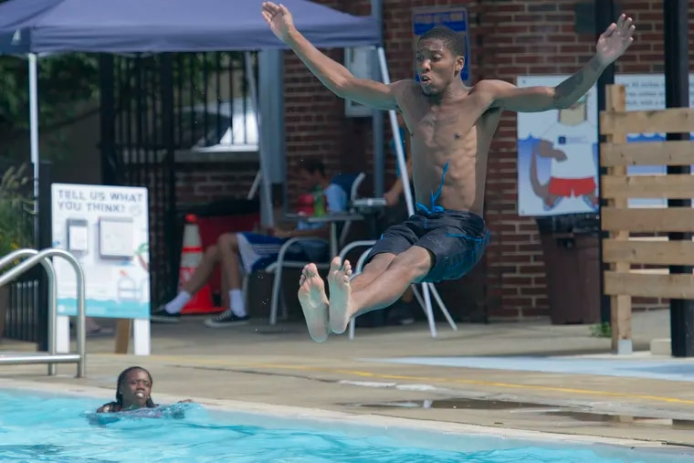 Khalil Brooks, 23, Southwest Philly, prepares to cool off in the Taney Pool near South Street on a hot and humid day in August 2016.