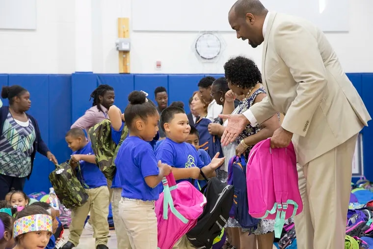 Assemblyman Arthur Barclay, front right, was arrested earlier this month on a charge of simple assault and is expected to resign. He is pictured here at KIPP Cooper Norcross Academy in Camden in 2016.