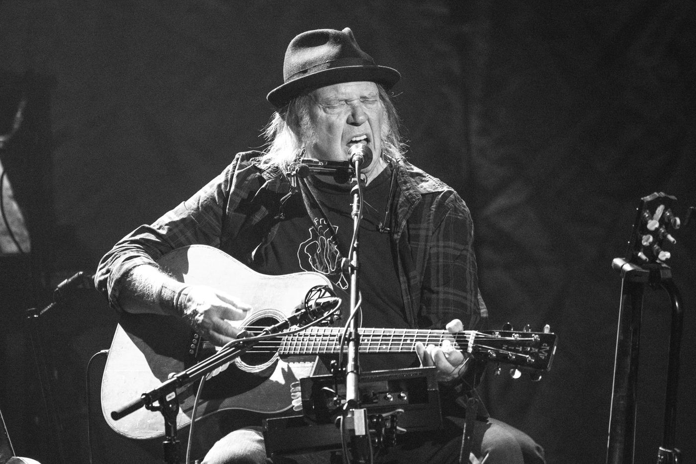 Review: Neil Young, quietly electrifying while flying solo at the Tower