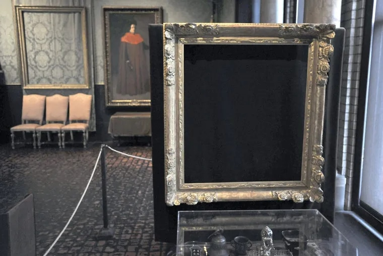 """In this 2010 photo, empty frames from which thieves took """"Storm on the Sea of Galilee,"""" left rear, by Rembrandt and """"The Concert,"""" right foreground, by Vermeer, remain on display at the Isabella Stewart Gardner Museum in Boston. Midnight Dec. 31, 2017, is the deadline to collect a doubled reward being offered for information leading to the recovery of 13 works worth an estimated $500 million."""